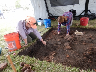Archaeologists doing fieldwork.