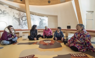 Elders sit on the floor of the Knowledge Sharing Centre at the CHARS building, Ikaluktutiak. Credit: Alex Fradkin