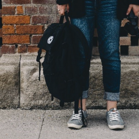 Student standing with backpack