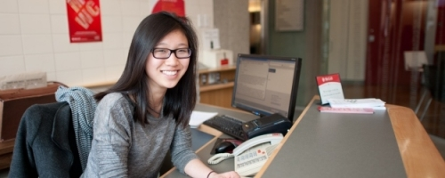 Sandra Lam (U2 Classics & Poli Sci) works the front desk at Service Point – a one-stop-shop for loads of student services.