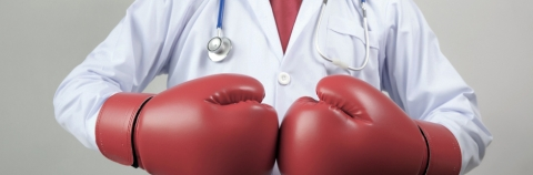Doctor wearing boxing gloves