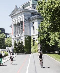 People biking or walking on McGill's downtown campus.