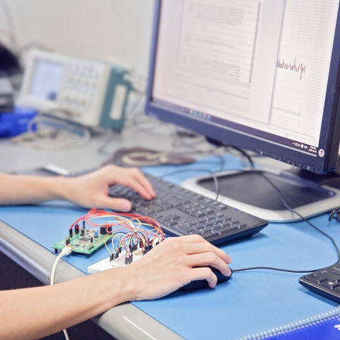 a student working on a computer.