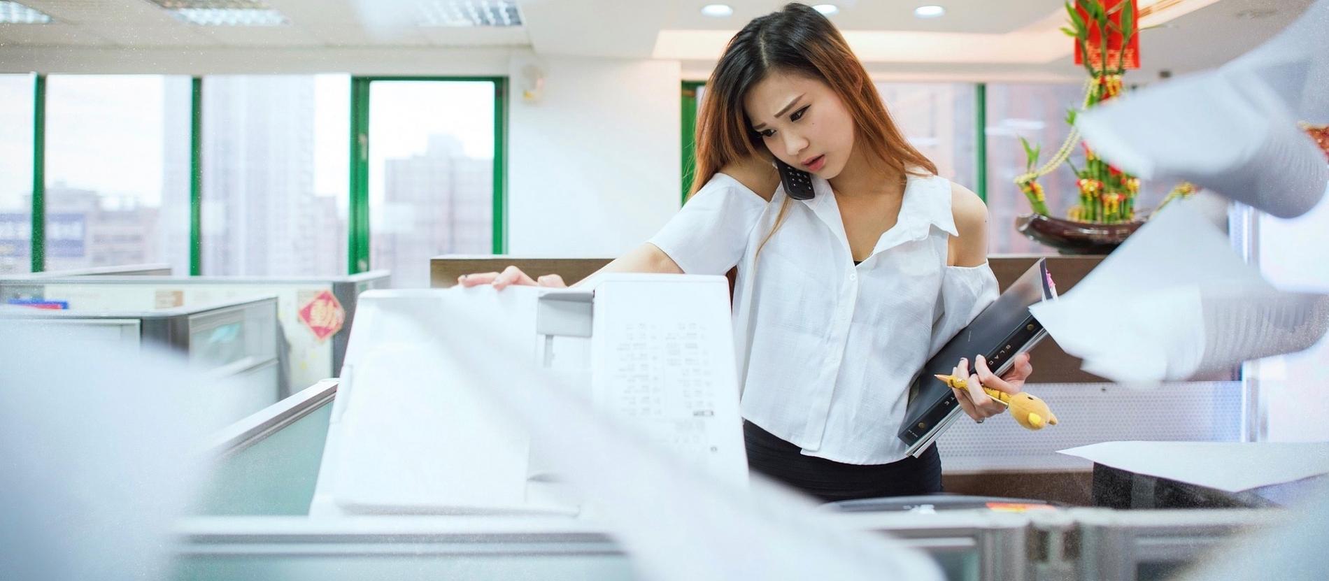 Women using a photocopy machine