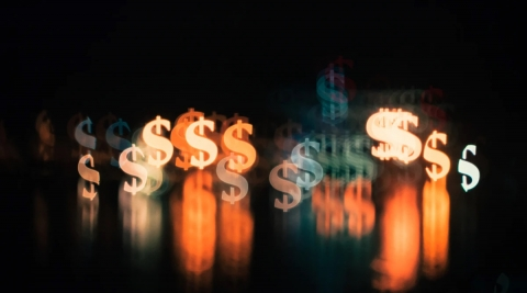 Dollar signs in different colors on a black background with funding opportunities available