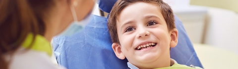 Young boy with dental surgeon