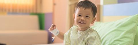 Smiling boy on hospital bed