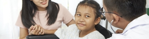 Pediatric ophthalmologist with young girl