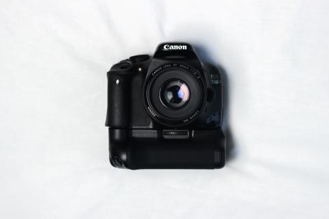 camera lying on a white sheet