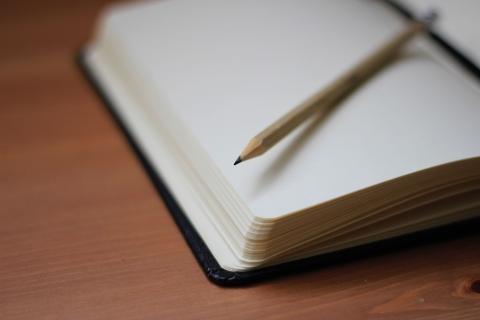 Blank notebook with a pencil
