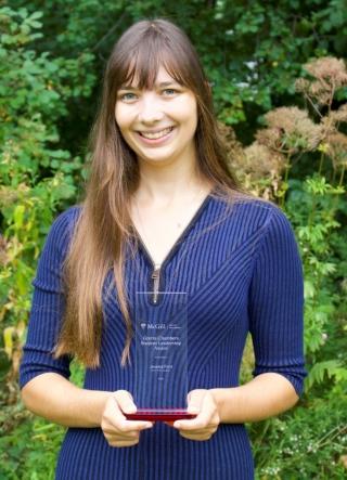 Jessica holding her Gretta Chambers award