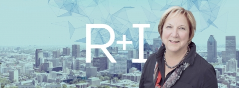 Photo of VP Research, Martha Crago with a view of downtown Montreal behind her.