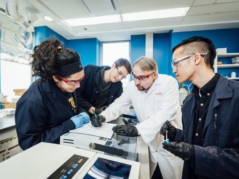 Prof. Tomislav Friscic working with students in his lab