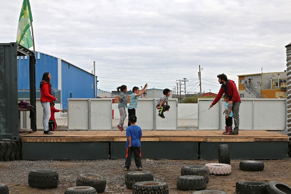 Kids jump rope on the new outdoor stage in Kuujjuaq