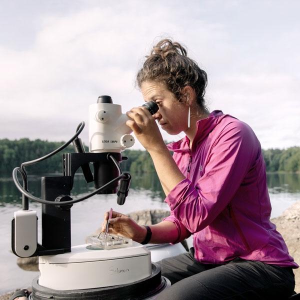 Dalal looking into a microscope