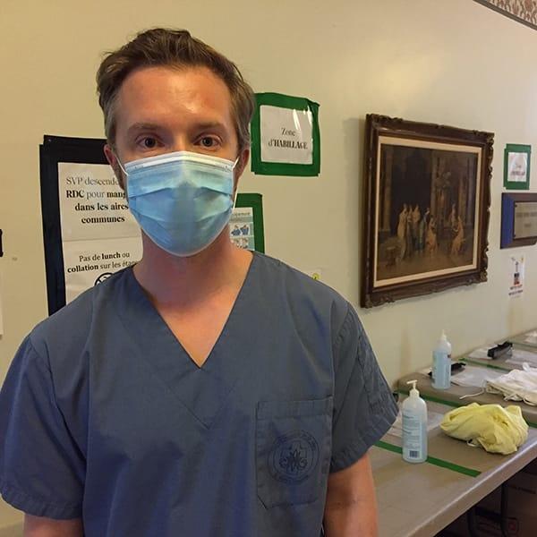 Photo of Ryan Hicks wearing a mask