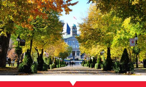 McGill Arts Building behind bright trees