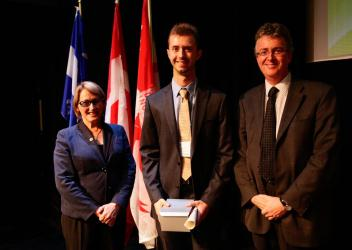 Joseph Lewnard receives a prize at the Undergraduate Research Conference.