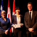 Erica Yoon (centre) with Dr. Suzanne Fortier and Dean Martin Grant.
