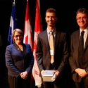 Joseph Lewnard (centre) with Dr. Suzanne Fortier and Dean Martin Grant.