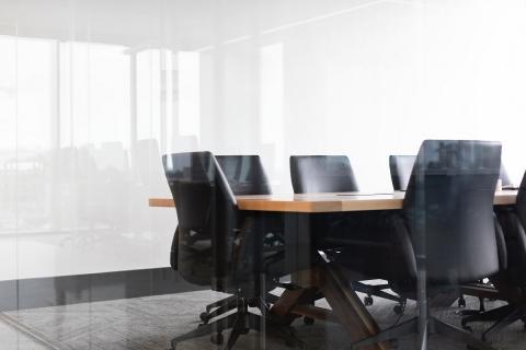 Stock photo of chairs around desk