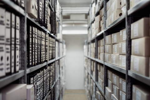 Stock photo of boxes and files on shelves