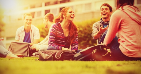 Students sitting on grass and talking