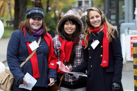 Three students wearing McGill scarves and nametags