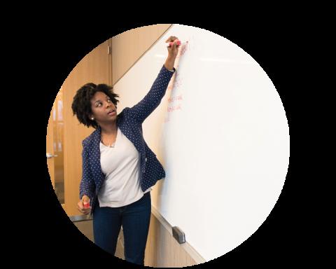 Instructor writing on whiteboard