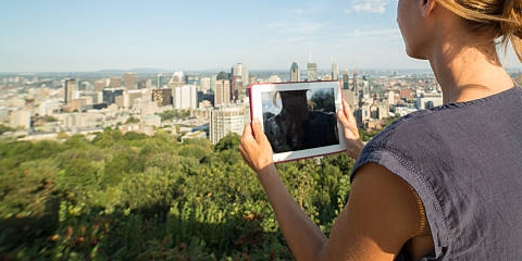 A graduate student takes a photograph of the Montreal skyline