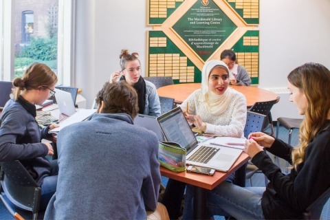 Students sitting around a table at Macdonald Campus