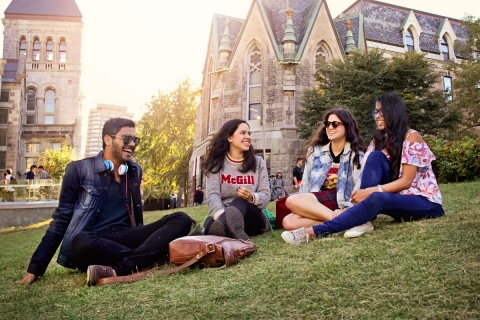 Students gathered on grass on campus