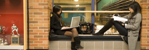 two female students studying in an alcove