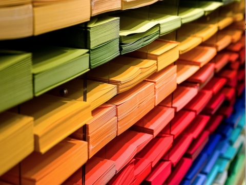 rainbow-coloured stacks of papers