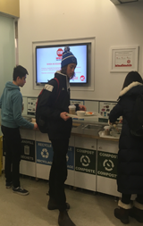 Photos of students in royal victoria college caf using waste disposal system