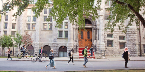 Students walking in front of Redpath Hall in Summer