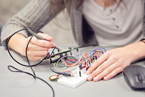 Woman working on a circuit board
