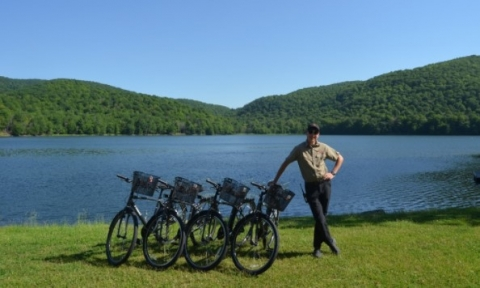 McGill staff leans against bikes at the Gault Nature Reserve