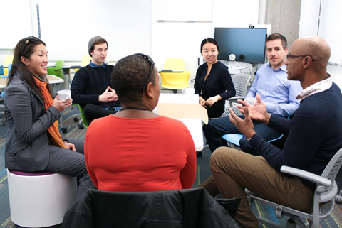 Students and staff sitting in active learning classroom