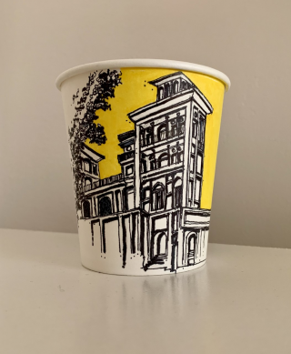 Coffee cup with a sketch on it