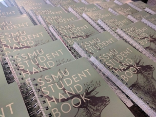 SSMU student handbooks layed out on table