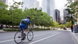 A cyclist rolls down a bicycle lane in downtown Montreal