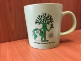 A mug branded for the Green Labs Initiative at the Neuro