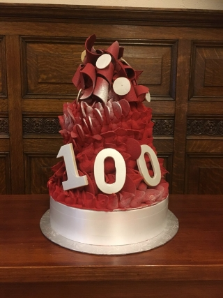 A fanciful red and white cake marking 100 years of tax law in Canada