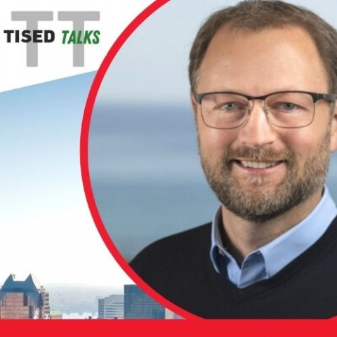 TISED TALKS logo with skyline of Montreal in the day and headshot of Dr. Eric Masanet