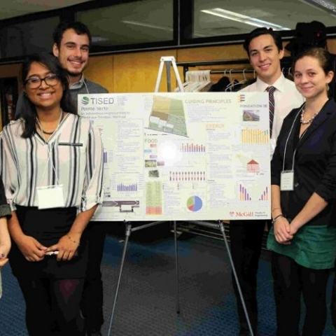 A group of students standing around a poster board