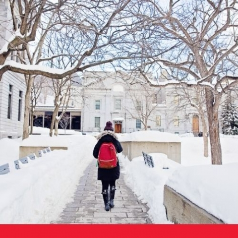 image of mcgill campus in winter with student walking with red backpack