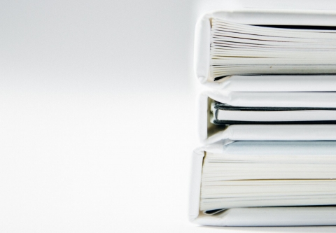 stack of white binders on a white background