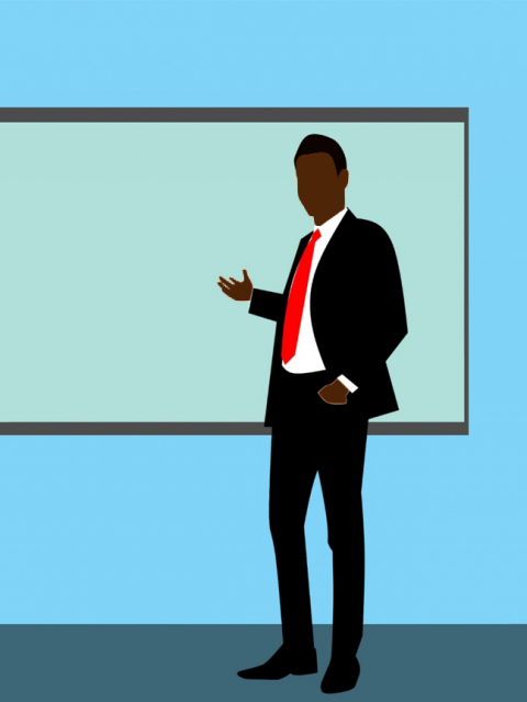 Coloured outline of a black teacher giving a presentation in front of a board