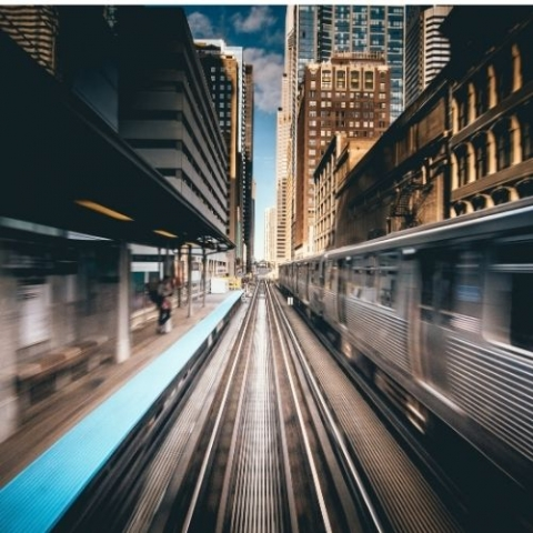 image of outside subway tracks with train with a highspeed effect blurring lines